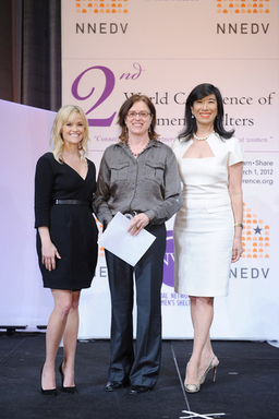 Ann Decter of YWCA Canada receives the Avon Innovative Campaign Award from Honorary Chairman of the Avon Foundation for Women Reese Witherspoon and Avon Chairman & CEO Andrea Jung.