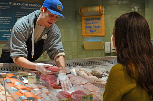Whole Foods Market fishmonger selling yellow-rated tuna