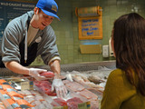 Whole-foods-market-fishmonger-selling-yellow-rated-tuna-sm