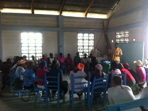 Haitian farmers in a coop getting trained