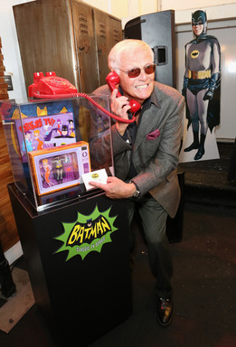 Adam West with Mattel's 2013 San Diego Comic-Con Exclusive Batusi Batman figure at the launch of WBCP and Junk Food Clothing's Batman Classic TV Series product line at Meltdown Comics on Mar 21, 2013.