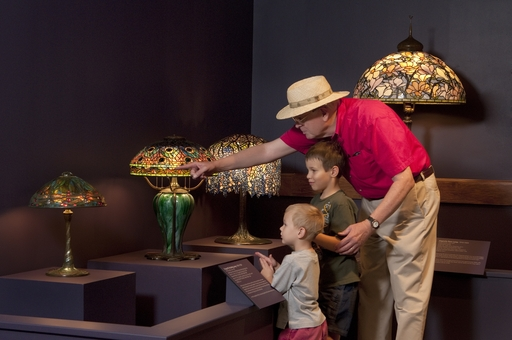 Guests at the Tiffany at Biltmore exhibition get a close view of Louis Comfort Tiffany's exquisite artwork