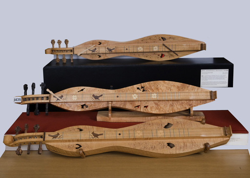 Cherry and walnut dulcimers by Edd L. Presnell of Banner Elk, N.C., part of the R.J. Reynolds' art collection being provided to the Arts Council in Winston-Salem.