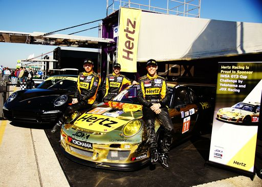 JDX Drivers, from left to right, Mike Hedlund, Jon Fogarty, and Jan Heylen, with Hertz-Sponsored JDX Race Car