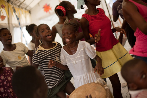 Students dancing at Concern's Transitional Learning Spaces, a welcome escape from the realities of life in a displacement camp. Photo: Port-au-Prince, Haiti, Concern Worldwide