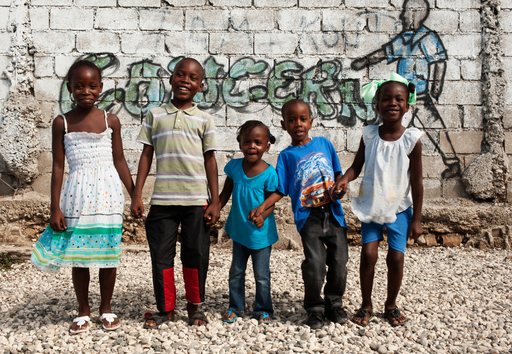 Primary school-age children outside of Concern's Transitional Learning Space at Place-de-la-Paix settlement. Photo: Port-au-Prince, Haiti, Concern Worldwide