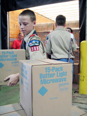 Boy Scouts load Trail's End popcorn for delivery, in preparation for their annual sale starting in September