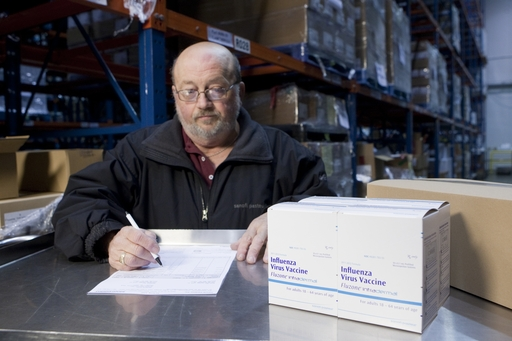 A Sanofi Pasteur employee prepares Fluzone Intradermal vaccine for shipment