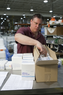 A Sanofi Pasteur employee helps package the first shipments of Fluzone Intradernal vaccine