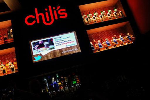 Brazilians tweeted about Chili's Moema which scrolled across the restaurant's flat screen TVs during the opening event.