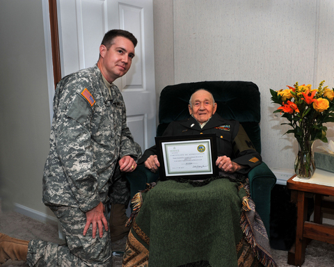 A Veteran of three wars is honored for his service to our nation by Capt. Tillman, a serviceman volunteering with We Honor Veterans program at a Savannah hospice