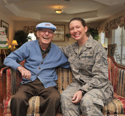 Bonds among service members are strong: Here, hospice volunteer Suzy Willis, SSgt. US Air Force spends time with WWII Veteran Neil Johnson.
