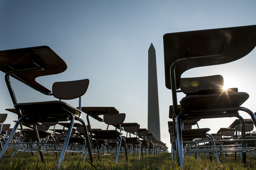 857 desks on the National Mall, part of the College Board's Don't Forget Ed campaign, represent the number of students who drop out of school every hour of every school day.