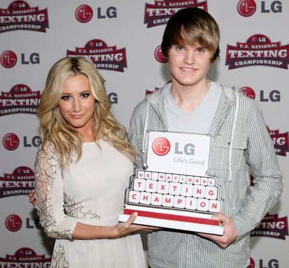 2011 LG U.S. National Texting Championship spokesperson, actress Ashley Tisdale, and Championship winner, Austin Wierschke, celebrate post-competition