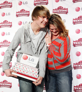 2011 LG U.S. National Texting Championship winner, Austin Wierschke, shares in his texting glory with mom, Lisa Wierschke, after being named the fastest texter in the nation