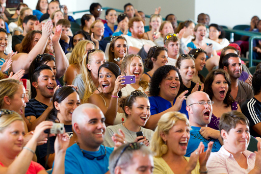St. George's University students celebrate as Chancellor Charles R. Modica announces that the Veterinary Medical School had earned full accreditation by the AVMA Council on Education
