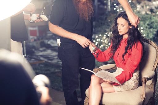 Demi Moore takes a break to peruse Ann Taylor's Holiday 2011 lookbook while on set shooting the brand's ad campaign in Los Angeles