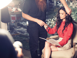 Demi-moore-takes-a-break-to-peruse-ann-taylors-holiday-2011-lookbook-sm