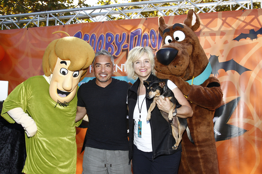 Cesar Millan and Warner Bros. Consumer Products EVP, Karen McTier, are joined by Scooby and Shaggy on stage to kick-off the Pack Walk event.