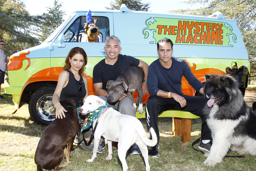 "Cesar Millan (center) with celebrity friends from ""General Hospital,"" Lisa LoCicero (left) and Maurice Benard (right) at the Pack Walk event."