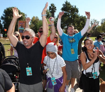 Cesar Millan and his son, Calvin, lead the pack of over a thousand dogs and their owners to the Pack Walk finish line.