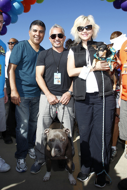 (from left) Los Angeles City Councilman 6th District, Tony Cardenas, Cesar Millan with his dog, Junior, and Karen McTier, EVP, Warner Bros. Consumer Products, kick-off the Pack Walk.