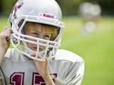 52660-kid-fixing-helmet-riddell_midseason_1-sm