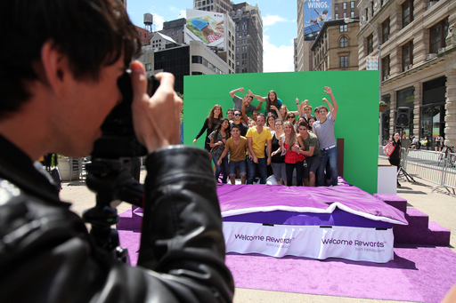 A photographer snaps a photo of over 20 energetic teens as they are virtually transported to their perfect place during the Hotels.com Welcome Rewards Bedventure event in New York City's Flatiron District.
