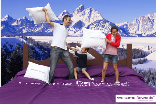 A family takes part in an epic pillow fight with the Teton Mountains of Wyoming as a backdrop at the Hotels.com Welcome Rewards Bedventure event in New York City's Flatiron District.