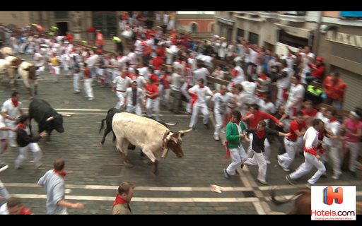 Andy Bell books his hotel in Pamplona, Spain through the Hotels.com app while racing to stay ahead of the stampede to demonstrate the ease of the app even while running with bulls