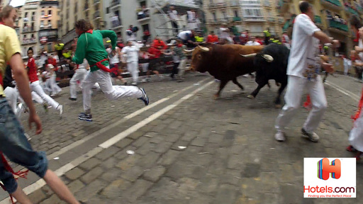 Stuntman Andy Bell is on the horns of the bulls while navigating through the intense crowds and booking his hotel on the Hotels.com app