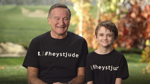 "Robin Williams and St. Jude patient Brennan share a laugh while filming the new ""Hey Jude"" video."