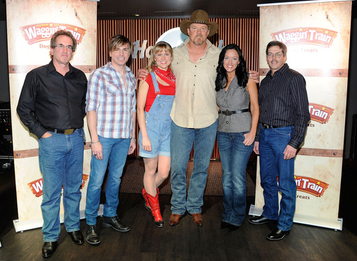 The five finalists in the Waggin' Train® Tail Waggin' Jingle Contest celebrate with Country Music star and contest judge Trace Adkins at the Hard Rock Café in Nashville