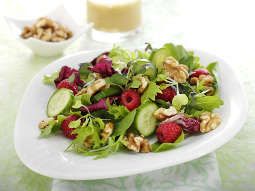 Enhance your everyday salad with a fresh topping of raspberries, cucumbers and Fisher® Walnuts