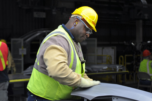 A Toyota team member inspects Corolla parts at the new Mississippi plant.