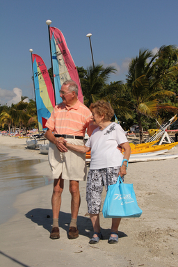 The 90- and 82-year-old newlyweds Molly and Ed Nisbett enjoy a walk on the beach during their honeymoon at Breezes Grand Negril in Jamaica. The couple met last year on Match.com.