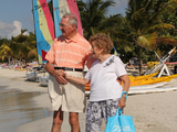 53179-ed-molly-on-beach-with-sails-in-background-sm