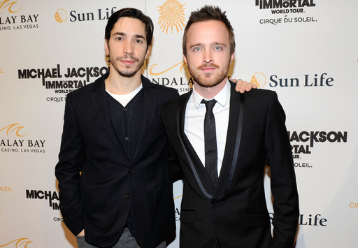Actors Justin Long (L) and Aaron Paul arrive at the Las Vegas premiere of Michael Jackson THE IMMORTAL World Tour by Cirque du Soleil at the Mandalay Bay Resort & Casino.  (Photo by Ethan Miller/Getty Images for Cirque du Soleil)