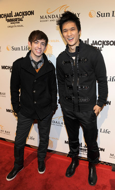 Actors Kevin McHale (L) and Harry Shum Jr arrive at the Las Vegas premiere of Michael Jackson THE IMMORTAL World Tour by Cirque du Soleil at the Mandalay Bay Resort & Casino.  (Photo by Ethan Miller/Getty Images for Cirque du Soleil)