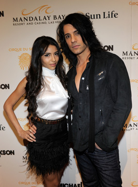 Illusionist Criss Angel (R) and his fiancee Sandra Gonzalez arrive at the Las Vegas premiere of Michael Jackson THE IMMORTAL World Tour by Cirque du Soleil at the Mandalay Bay Resort & Casino.  (Photo by Ethan Miller/Getty Images for Cirque du Soleil)