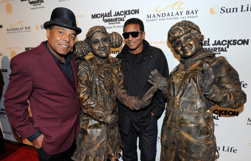 Tito Jackson (L) and Jackie Jackson (3rd L) pose with Cirque du Soleil performers at the Las Vegas premiere of Michael Jackson THE IMMORTAL World Tour by at the Mandalay Bay Resort & Casino (Photo by Ethan Miller/Getty Images for Cirque du Soleil)