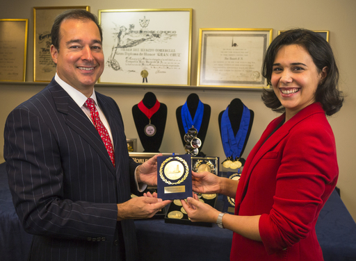 Bacardi Chairman Facundo L. Bacardi and Patty Suau of The Bacardi Archive showcase some of the medals awarded to BACARDÍ rum, including the Monde Selection 2012 Grand Gold Award.