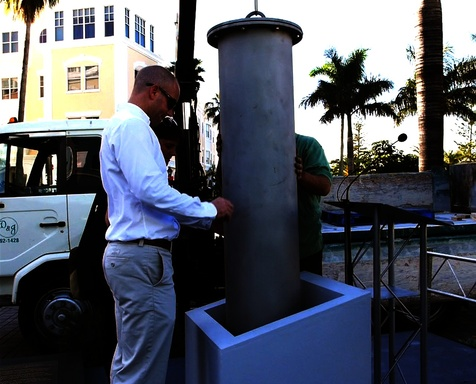 Lowering the custom-created, stainless steel capsule into its home for the next 50 years at the iconic Bacardi headquarters building in Bermuda, a popular tourist attraction.