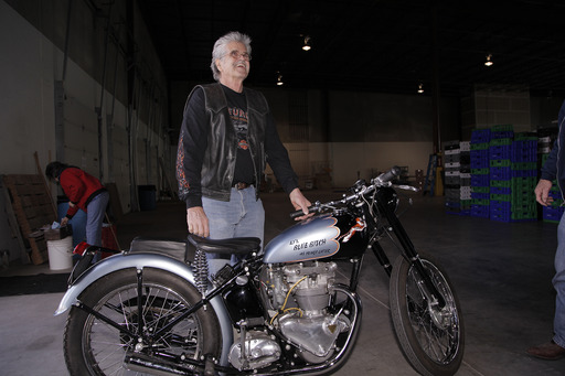 Don Devault had a sign painter on hand to immediately put the original name of his bike back on the gas tank. The unique name helped NICB Agent Lou Koven confirm that Devault was the original owner.
