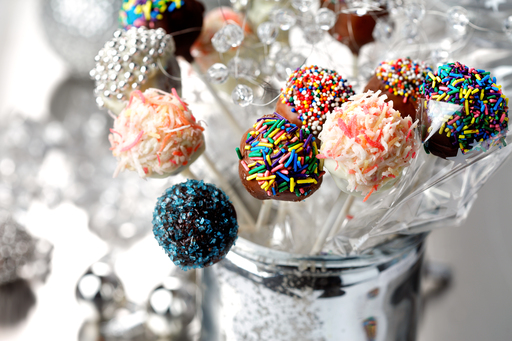 These brownie pops are an irresistible combination of cocoa powder, semisweet chocolate chips and sprinkles in one little ball. Canola oil helps bind all of the decadent ingredients together.