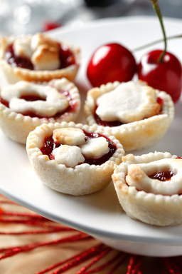 Orange juice and zest make these fun-sized cherry pies a refreshing, tangy dessert. With canola oil, these treats are better-for-you than traditional pies.