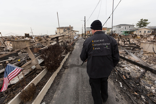 Assurant Specialty Property Field Claims Adjuster Kevin Palka assesses damage from Superstorm Sandy in the Breezy Point neighborhood, Queens, NY
