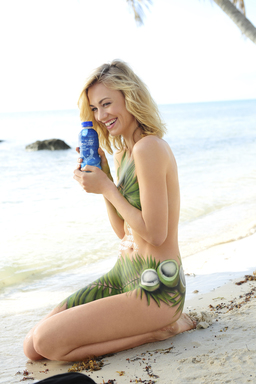 "Painted in palms and coconuts, ""Chuck"" Actress Yvonne Strahovski turns up the heat in her SoBe Skinsuit to launch new SoBe Lifewater with Coconut Water."