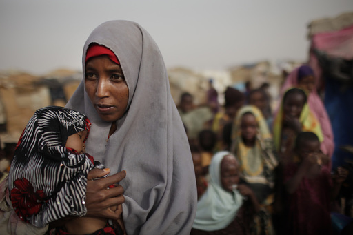 Mother and child awaiting food and medical assistance. Photo Credit: Ed Ou/Getty Images for Save the Children