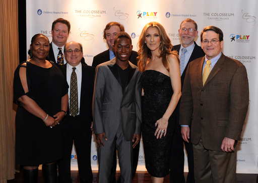 Mrs. Green, Dr. Matthew Heeney, Dr. Stu Orkin, Gary Loveman, singer/songwriter A.J. Green, Celine Dion, Dr. Gary Fleisher and Dr. Dave Williams pose for photos backstage at Caesars Palace on January 15, 2012 in Las Vegas, NV.